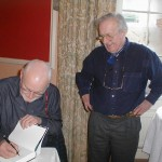 Dr. Cooper signing a copy of his biography of Bernard Leach for Tarquin