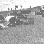 Cars parked on Camber Sands.