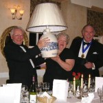Tony and Sheila Mann holding the lamp aloft whilst Kerry de Courcy