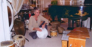 Liz Butt among her collection of Musical Instuments