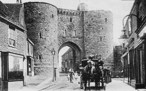 A two horse coach being driven down King's Street (Landgate)