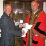 Mayor Osborne presents National Championship medal to Barry Goodsell