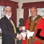 Mayor Osborne presents National Championship medal to Jim Hollands