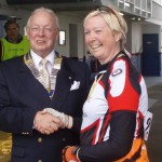St. Leonards Rotary Club President presents Aly Nye with her medal for completing the 40 mile cycle