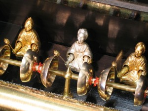 A cylinder musical box attributed to 'George Bendon'circa 1895. The six bells are struck by three automaton figures representing Japanese gentlemen. An example of how the musical box industry was trying to adapt to current fashions and changing tastes.