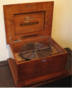 l box, 'Mira'  Swiss circa 1905. 32 original discs 30.5 cm (12 inches) in diameter. The drawer at the bottom of the case is designed to hold a selection of discs. This musical box plays with a very bright, distinctive tone, speed regulator and zither.