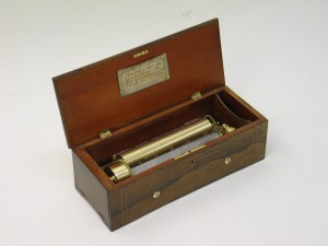 A superior quality cylinder musical box by B.A. Bremond of Geneva circa 1885 playing 8 airs as listed on original tune sheet. Serial number 23453 Gamme number 1598 Case 55cm/21.5 inches long, 23cm/9 inched deep, 15cm/6inches high. Burr Walnut with boxwood stringing and tulipwood crossbanding.
