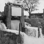 Water flows over the Sluice Gates in Winchelsea Road on an unexpected High Tide in 1966