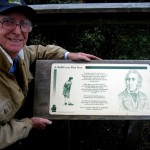 """Richard Holdsworth, author of this article, with a plaque commemor a t i ng J ohn Pa s c oe Fawkner, one of the first settlers who became known as """"Father of Melbourne"""