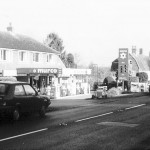 """""""Beckley Motors in December 2000, with 'The Pines' and 'Dengates' in the distance, opposite which was the original garage"""" """"The Village Bus Remembered"""""""