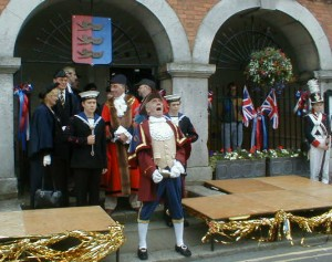 Rex Swain the Rye Town Crier at work outside the Town Hall