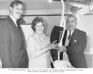 im Hollands Snr. Presents a Star Prize to Mrs Everett of Camber with Hoover Representative Denys Norton Looking on