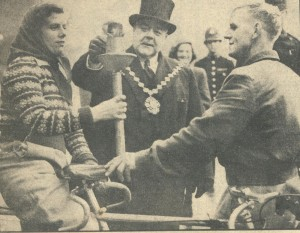 Jim Sargent and Mrs. Sargent hold the torch as the Mayor of Westminster lights the flame that will be carried 60 miles to Rye to light the Rye Bonfire of 1948