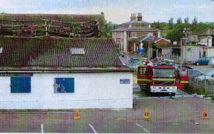 Flashback - They Day After the Fire.  Both buildings were virtually gutted.