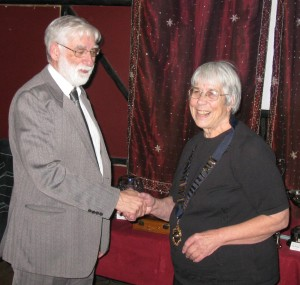 Jim Hollands (outgoing President) hands over the Chain of Office to Esther Carpenter of Southborough Wheelers