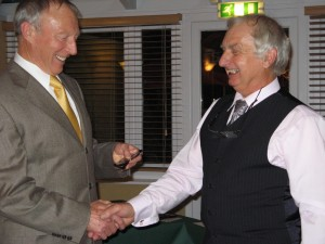 Roy Manser presents an award to Gary Booth, Racing Secretary and Trophy