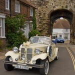 The couple were driven around the town in an open top Bentley Beauford.
